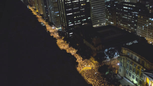 100,000 people take to the streets of Rio de Janeiro to protest a 10 cent bus fare hike. June 2013