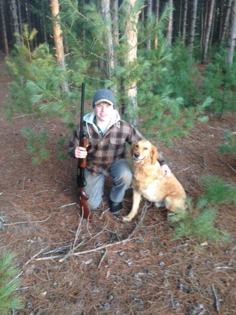 Me with my grandfather's shotgun given to me, and my dog Murphy