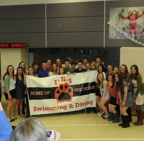 Members of last years swim team pose for a picture at the end of the year banquet
