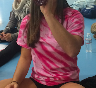 Issy Cerundolo stays hydrated before she hits the mat for practice.